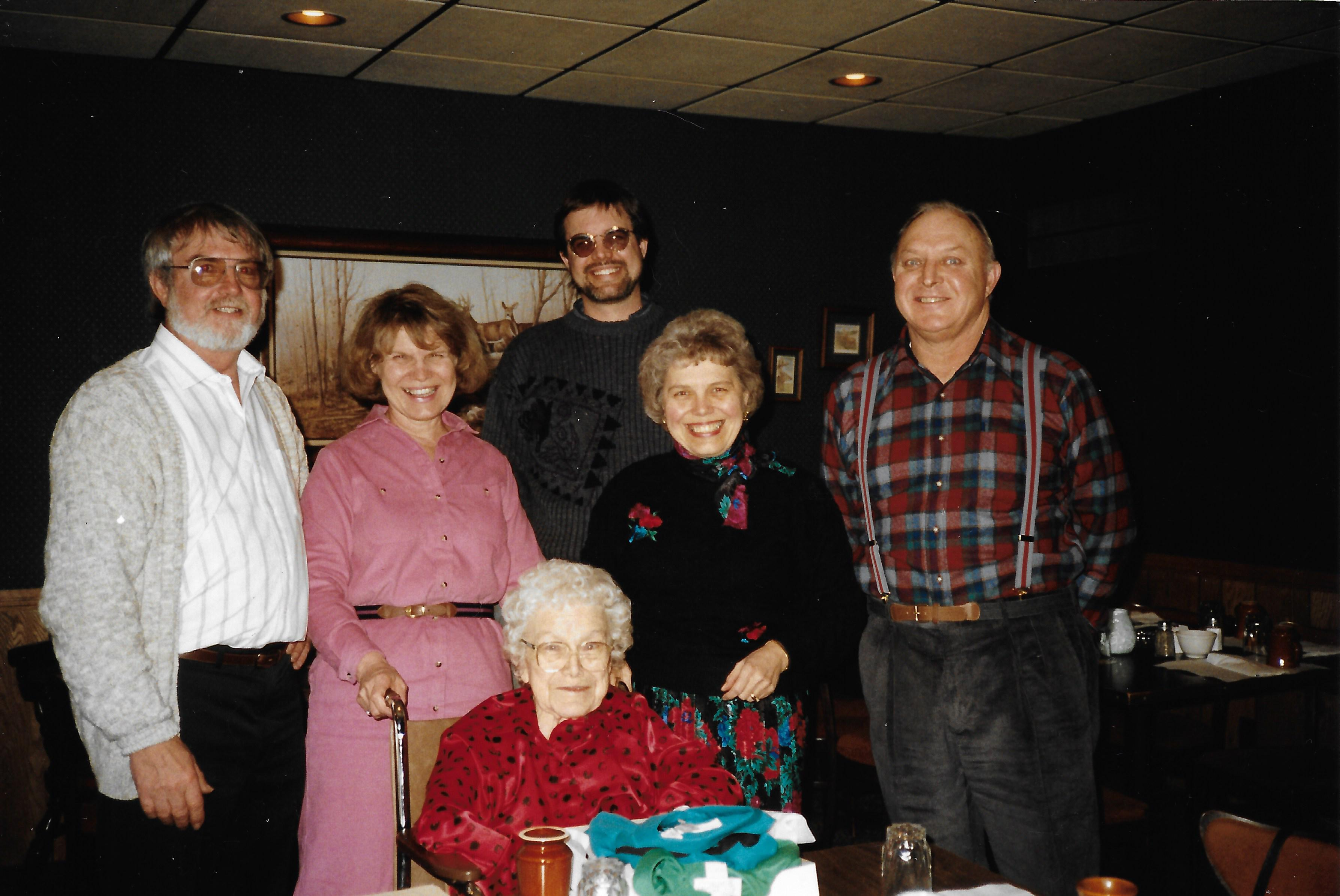 Lorain Berg, Julia Berg, Steven Berg, Rita Liberacki, and John Luks help Rachel Wilcox (seated) enjoy her 82nd birthday.